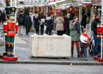 FRANCE, Paris: A concrete block is seen at one of the entries of the Champs Elysees Christmas market in Paris on December 24, 2016 after security measures were increased following the Berlin attack. - Michel STOUPAK