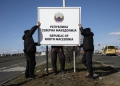 "Workers erect a new road sign reading ""Republic of North Macedonia"" at the Greece-Macedonia Bogorodica border crossing near Gevgelija, Republic of North Macedonia, on Wednesday, February 13, 2019. A former Yugoslav republic thats been blocked from joining NATO and the European Union because of a dispute over its name has started using a new moniker thats the result of a deal to open the doors to western integration. Photographer: Konstantinos Tsakalidis/Bloomberg via Getty Images"