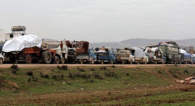 FILE PHOTO: A general view of vehicles carrying belongings of internally displaced Syrians from western Aleppo countryside, in Hazano near Idlib, Syria, February 11, 2020. REUTERS/Khalil Ashawi - RC2HYE9DKC59/File Photo