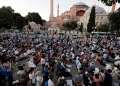 Muslims gather for evening prayers in front of the Hagia Sophia or Ayasofya, after a court decision that paves the way for it to be converted from a museum back into a mosque, in Istanbul, Turkey, July 10, 2020. REUTERS/Murad Sezer