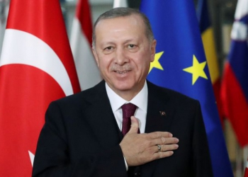 FILE PHOTO: Turkish President Tayyip Erdogan reacts ahead of a meeting with EU Council President Charles Michel pose in Brussels, Belgium March 9, 2020. REUTERS/Yves Herman/File Photo