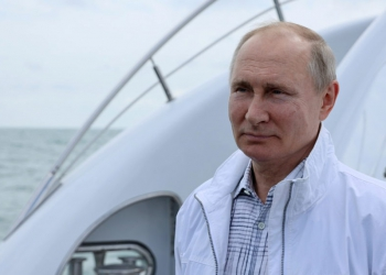 Russian President VladimirPutin looks on during a boat trip with his Belarusian counterpart Alexander Lukashenko off the Black Sea coast, Russia May 29, 2021. Sputnik/Sergei Ilyin/Kremlin via REUTERS ATTENTION EDITORS - THIS IMAGE WAS PROVIDED BY A THIRD PARTY.