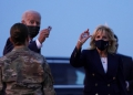 U.S. President Joe Biden and first lady Jill Biden hold up challenge coins, as they depart RAF Mildenhall, ahead of the G7 Summit, near Mildenhall, Britain June 9, 2021. REUTERS/Kevin Lamarque
